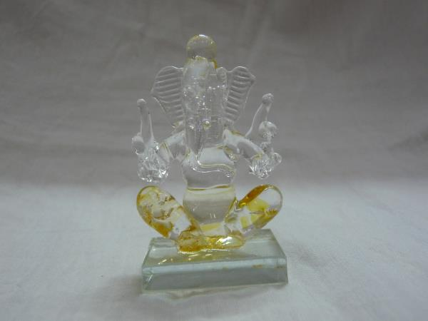 Return Gift Items Online Glass Ganesha 2.75 inches height. 1.75 inches Rs 125 width.http://pujacelebrations.com/gift-articles/15947-glass-ganesha-yellow.html - by Puja Celebrations. Call Us @ 9087270009, Chennai