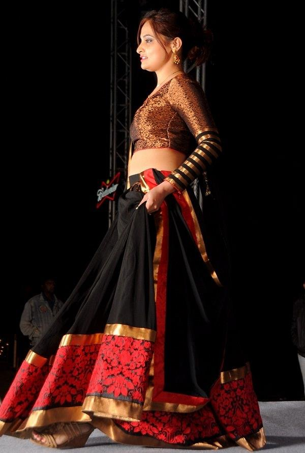 Black and Red Royal Lehenga Choli  Be the showstopper of the night with this gorgeous lehenga choli. Get a full flared lehenga designed with beautiful floral embroidery and gold lace work on its border, and pair it with a matching designer full-sleeve choli with gold stripes on its sleeves. Together with a bordered dupatta, this outfit will surely catch the eye of many admirers.  #Printed Lehengha Choli At Lowest Price  SHOP NOW: http://www.myshopmall.com/Single/Lahenga/Lehenga-Art-Silk-Choli-Art-Silk-Dupatta-Net-Multi-Heavy-Worked-Lahenga-1-3