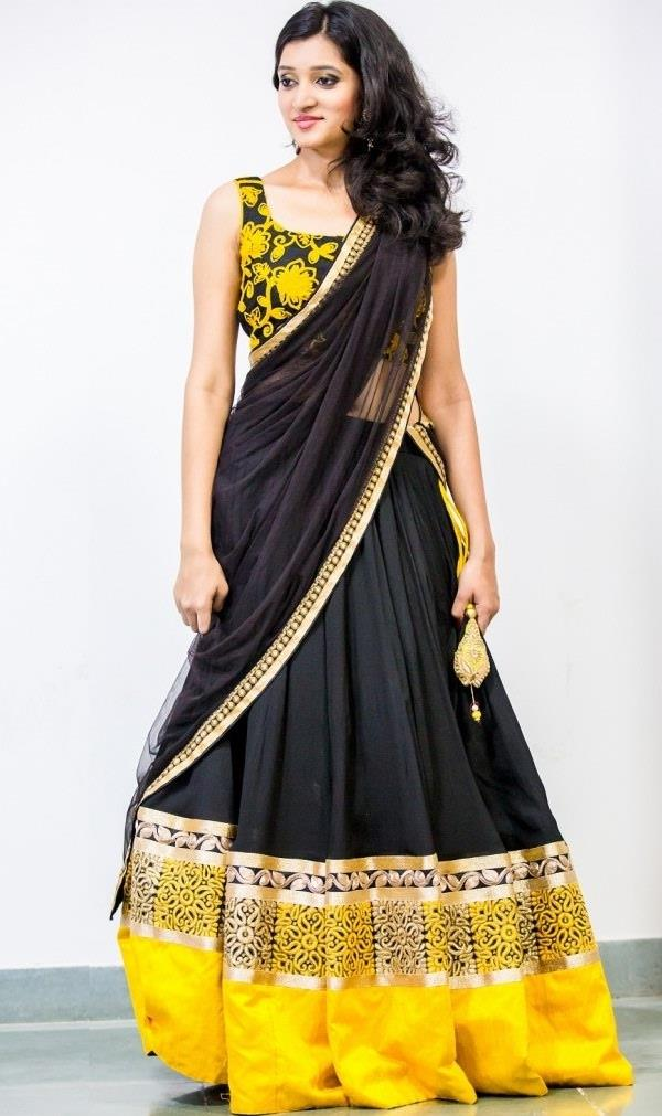 Enchanting Black and Yellow Lehenga Choli  This is the perfect pick for those who prefer minimalistic elegance. Choose a striking color combination and add their dramatic effect to the attire. Enhance the look with some delicate embroidery work and lace work, and go for a sleeveless choli with same detailing to compliment the outfit.  #Simple Lehengha Choli At Lowest Price  SHOP NOW: http://www.myshopmall.com/Single/Lahenga/Lehenga-Art-Silk-Choli-Art-Silk-Dupatta-Net-Multi-Heavy-Worked-Lahenga-1-4
