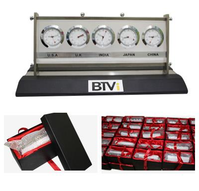 Stylish desktop clocks add value to your desk. Giftt Hub's unique combination on wooden and glass world time clock is a perfect give away to your top corporate clients. This contemporary world time clock can be customised as per the client requirement. 5 different counties can be added.  The desktop world time clock was chosen as a corporate gift by our esteemed client BTVI for an event.Giftt Hub customized the clock and packed the clock in a top and bottom cushioned box with satin fabic inside and a ribbon on the outside.BTVI logo was engraved on the world time clock as per the company logo guidelines.