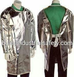 "Manufacturers and Exporters of Aluminized Back Open Jacket in India:-  We are Manufacturers and Exporters of Aluminized Back Open Jacket which is made out of imported Aluminized Glass Fiber fabric with dual mirror having 90% reflection of heat as a outer layer and with woolen fabric lining. Additional layer (Vapour Barrier), stitch with 4 Core aramid yarn, is also used for higher temperature and to work near close proximity area.  Features: •	The Jacket is Open from back side. •	The back open Style of the jacket helps to keep the body cool of the person. •	Very light in weight and gives comfort. •	Temperature capacity 800 °C to 1200 °C   Size:-  •	Long 48"", Inches, Chest 36"" inches, Sleeves 22''   Applications: These Aluminized Coat are used for in rescue operations in an area of intense heat, fire, steam, hot liquid by fire fighters in industries like petrochemical plants, Foundries, plant, steel, glass, ceramics & defence.  Additional Information:-  •	We are MANUFACTURER AND EXPORTER OF ALUMINIZEDBACK OPEN JACKET. So we can customized the Jacket as per your requirement."