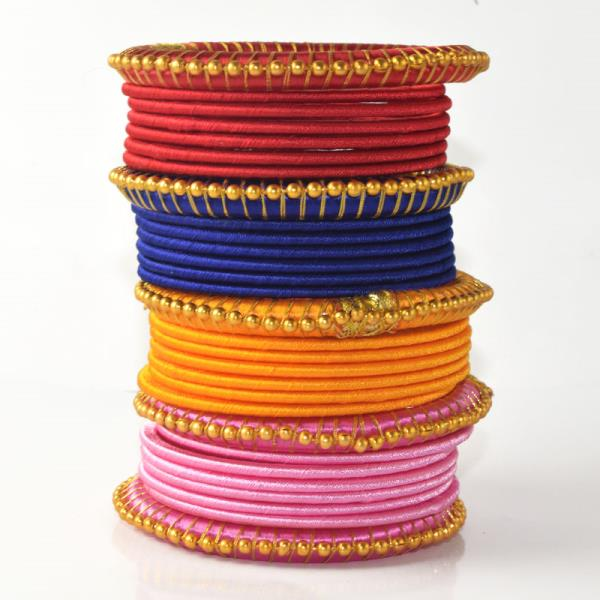 Indian Handcraft Very Beautiful Colours For Parties Silk Thread Bangles Set Set of 28 PC  Perfect for Party Function, Marriage and Mehandi Function Indian Manufacturer & Wholesaler,  Available Sizes are 2.2, 2.4, 2.6, 2.8, 2.10 Product Code: B093 Price INR: 319/Set Price US$: 5.3/Set  AUSTRALIA/CANADA/FIJI/MALAYSIA/MAURITIUS/SINGAPORE/UK/US