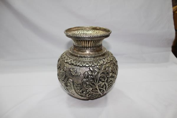 German silver handcarved pot.  We are manufacturer of  home decor items like handcarved german silver items, aroma scented candles in soy and bees wax  we can customise fragrance size and shape of candle and we can make different kind of home decor items.  you can visit us at www.bhrtiimpex.com