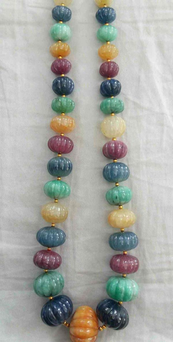 Multi Melon Beads  All Are Natural Stones  Blue Sapphire  Ruby  Yellow Sapphire  Emerald  Price - 50 Rs Per Carat  For More Information Contact Us