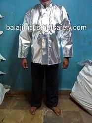 "Manufacturer and Exporter of Aluminized Jacket in India:-  Aluminized Jacket is made out of imported Aluminized Glass Fiber fabric with dual mirror having 90% reflection of heat as a outer layer and with woolen fabric lining. Additional layer (Vapour Barrier), stitch with 4 Core aramid yarn, is also used for higher temperature and to work near close proximity area.  Feature : •	Temperature capacity 800 °C to 1200 °C •	Light in weight . •	Durable and Comfortable.   Size of Aluminized Jacket :- Long 34""Inches, Chest 54"" inches, Sleeves 22''   Applications: These Aluminized Jacket are used for rescue operations in an area of intense heat, fire, steam, hot liquid by fire fighters in industries like Petrochemical plants, Foundries, plant, steel, glass, ceramics & Defence  Additional Information:- We are MANUFACTURER AND EXPORTER OF ALUMINIZEDJACKET, so we can customized the Aluminized Jacket as per your requirement."