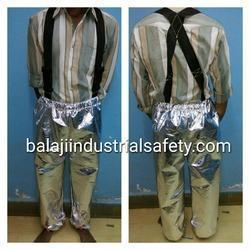 "Manufacturer and Exporter of Aluminized Pant in India:-  Aluminized Pant is made out of imported Aluminized Glass Fiber fabric with dual mirror having 90% reflection of heat as a outer layer and with woolen fabric lining. Additional layer (Vapour Barrier), stitch with 4 Core aramid yarn, is also used for higher temperature and to work near close proximity area.  Features:  •	Suspenders for adjustable length  •	Sewn-in elastic suspenders for adjustable pant drop  •	High waist with 2"" wide adjustable suspenders and adjustment straps on leg bottoms. •	Temperature capacity 800 °C to 1200 °C  Size:- (Size in Inches) •	Long 40""Inches, Waist 42"", Hip 46"", Thigh 26'', Bottom-20"".   Applications: These Aluminized Pant are used for in rescue operations in an area of intense heat, fire, steam, hot liquid by fire fighters in industries like petrochemical plants, Foundries, plant, steel, glass, ceramics & defence.  Additional Information:-  •	We are MANUFACTURER AND EXPORTER OF ALUMINIZED PANT, so we can customized the Pants per your requirement."
