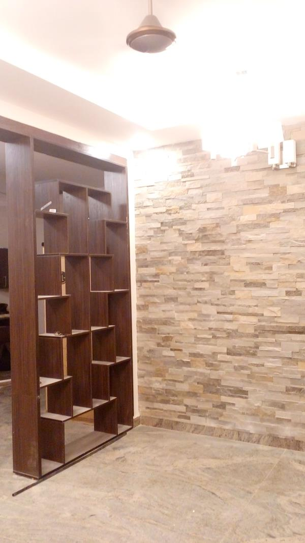 Partition Wall Have given partition wall with open ledges to keep decorative show pieces, flowerpots, books etc and the partition wall is made up of Laminate Finish and have give given Wall Cladding  and false ceiling with rope light. Pencil Interiors#Partition Wall#Hosur Road