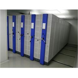 Perforated Mobile Storage Systems Manufacturer In Bangalore  Space Planners™ offers you the ultimate Perforated Mobile Storage Systems with the latest technology for a noise-free, effortless and smooth operation for years together. Mobile storage system offers the security of stored material and proves to be very cost-effective. Our offered perforated mobile storage system requires lesser space than conventional racking systems/cupboards.   Perforated mobile storage system glides on steel tracks and consists of mobile base units onto which different shelving options can be assembled.