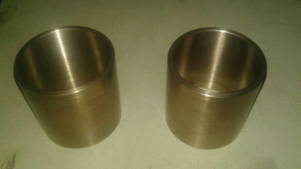 SINTERED SELF LUBRICATNG BUSH BEARINGS MANUFACTURER & EXPORTER: Oilite Industries produces the best quality ferrous & Non-ferrous Sintered Bearings which fully confirm to our customers total requirements at a competitive price. Sintered Self Lubricatng Bush Bearings are manufactured by us using powder metallurgy process. It has a strong & rigid structure due to complete alloying of the metals during manufacture. The porosity is distributed throughout the body by way of inter connecting channels & reservoirs. This results in a Self Lubricatng Bearing which provides automatic lubrication for long periods without attention.  APPLICATION : Sintered Self Lubricatng Bearing are used in Machine Tools, Pumps, Fans, Paper & Sugar Mills, Jute & Textile Mills, Cranes, Railways, Steel & Power Plants, Aviation Industries, Defence Ammunition Factories, etc..  FEATURES : *Dimensional Accuracy *Sturdy Construction *Self Lubrication *Wide Operating Temperature Range. *Low Friction *Flexibility of developing Customized Sizes. *Long Working Life.