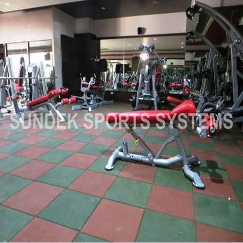 Gymnasium Flooring  We Sundek Sports Systems are manufacturers of  Gymnasium Flooring in Coimbatore.  As well as in India. Sundek Sports Systems offers a range of Gymnasium Flooring which is highly admired by the consumers for the stiffness and perfect finishing. These Gymnasium Floorings are made of superior quality material and have high durability. Our offered Gymnasium Flooring are weather resistant and available in different colors. These Gymnasium Floorings, beautify the interior of the applied place. All these Gymnasium Floorings pass thorough the quality check and are perfect. Our rubber flooring products, besides being of very high quality, are also available in a range of colours.   Features:   Non-slip Durable Soft underfoot Low maintenance Noise reducing Environment friendly Impact absorbing   Benefits:  High UV and weather resistance Excellent abrasion resistance and permanent elasticity Spike resistance even under constant load