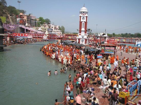 Haridwar is know wildly due to River Ganga Coming down from Mountain to land.(For package write uholidays@gmail.com or www.uniqueholidays.info)  It is an ancient city and municipality in the Uttarakhand. The Mighty river Ganga, after flowing for 253 KM  from its source at Gaumukh enters the Indo Gangetic Plains at Haridwar. It is regarded as one of the seven holiest places to Hindus. According to the Samudra manthan  Haridwar along with Ujjain, Nasik and Prayag is one of four sites where drops of Amrit, the elixir of immortality, accidentally spilled over from the pitcher while being carried by the celestial bird Garuda. This is manifested in the Kumbha Mela being celebrated every 3 years in one of the 4 places, and thus every 12 years in Haridwar. Amidst the Kumbha Mela, millions of pilgrims, devotees, and tourists congregate in Haridwar to perform ritualistic bathing on the banks of the river Ganges to wash away their sins to attain Moksha. Brahma Kund, the spot where the Amrit fell, is located at Hari ki Pauri literally,