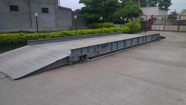 Foundation Less Weighbridge Manufacturer.  We are the prominent manufacturer of superior quality Foundation less Weighbridges. Our provided weigh bridges are generally used for weighing heavy load of tractors and trucks.  Features: •High precision •Superior performance •Commendable capacity  Benefits : • Modular Design- Machine supplied complete with platform, bottom frame and ramps • Needs no foundation • Installation in hours • Can be shifted to an other site easily • Keeps vigil on costly materials • Saves time and cost • Most suited for temporary sites