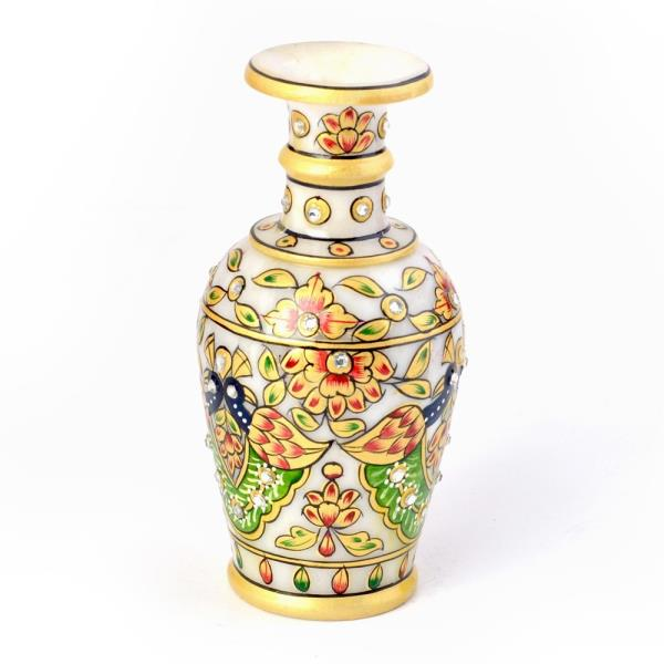 Buy Colorful Meenakari Work Peacock Design Flower Vase Online in Delhi  This handcrafted flower vase is made of Marble and decorated with colorful meenakari work. This golden meenakari Peacock Design gives a true Rajasthani royal touch to the hanging vase. Also, the painting on vase and gems work makes it more attractive.  It is an exclusive show piece for your drawing room; sure to be admired by your guests. Beauty of this product is it's golden meenakari work and gemstones work with quality, design and execution.  Click on the below link to view the product:  http://littleindia.co.in/colorful-meenakari-work-peacock-design-flower-vase-404/p539