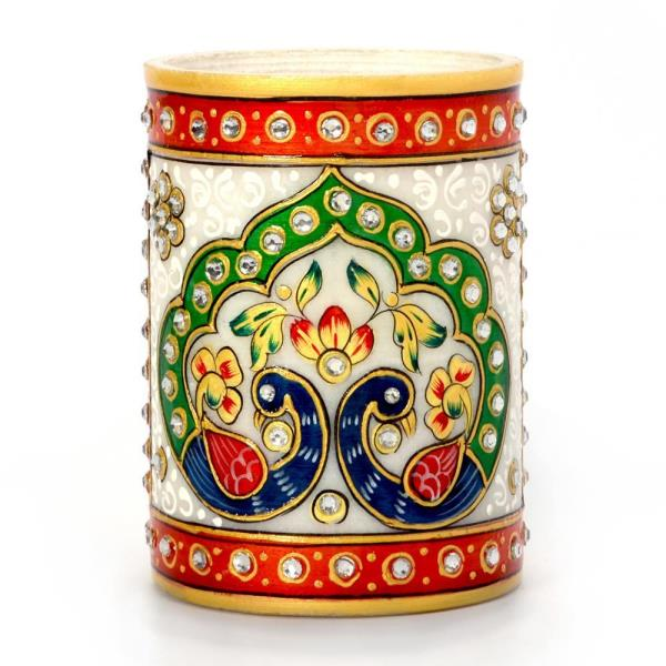 Buy Gold Meenakari Mayur Design White Marble Pen Stand Online in Ahmednagar  The unbeatable quality of this Marble Pen Stand offered by us has a unique glossy finish that impresses everyone. It has various gemstones setting around that enhances its beauty. Crafted in pure white marble, it is embellished with Meenakari and kundan work that is complemented by expert enamelwork. These pen stands are artistically crafted with appreciable designing by our skilled craftsmen giving it a eye catching look.   Click on the below link to view the product:  http://littleindia.co.in/gold-meenakari-mayur-design-white-marble-pen-stand-386/p522