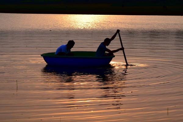 Enjoy a peaceful Evening #Coracle Ride on the #backwaters of #Kabini River. Call 9900969005 for bookings.