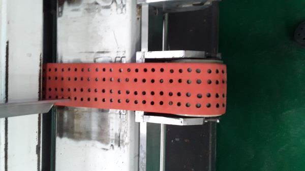 Feeder belts are moulded and coated with rubber on top for feeding the material into machines. Used in corrugated paper industry.