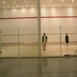 Squash Court Flooring  We C3Serface are manufacturing and supplying of  Squash Court Flooring in Mumbai.  As well as in India. In order to fulfill the changing demands of our customers, we are offering a quality range of Squash Court Flooring.These products are manufactured by the experienced professionals keeping in mind the impact loads, which are created when players or spectators run against the wall. The walls of the squash courts are tempered, toughened and celled for playing & viewing.   The Wall:    The walls of squash courts have flexural strength and provides excellent impact due to the superior quality raw material used in manufacturing. These walls are appreciated for their features such as resistance against crack, excellent bond, high durability and low maintenance cost. Moreover, we offer our customers a wide choice of standard alternatives in either freestanding or fixed-head types. We also offer a complete range of option for side and back walls for permanent tournament venues.     Glass Wall Fittings:     The glass wall fittings offered by us are manufactured in conformation with the WSF standards & specifications. These fittings are of high quality and have excellent strength nylon pieces, which help in strengthening a glass wall in the clients' squash or racket ball court. Our offered wall fittings are small and clean shaped to prevent any annoyance for players and spectators. Moreover, these fittings are FP four panel freestanding type along with full height glass support fins. The products have SP two panel freestanding version, which are made on the special order of the customers.     Resilience & Appropriate Friction:     The offered wooden floorings are manufactured by the professionals following the norms laid down by FIBA, WSF and MFMA in all aspects. These floorings provide controlled ball bounce as well as perfect comfort underfoot. Our floorings are highly resilient and are preferable for free floating sports floors. Each and every piec
