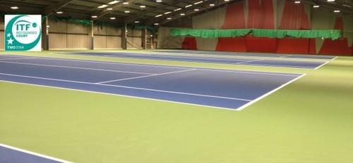 Outdoor Tennis Court Flooring Dimension:  Tennis is played on a rectangular, flat surface, usually grass, clay, or a hard court of concrete and/or asphalt. The court is 78 feet (23.77 m) long, and its width is 27 feet (8.23 m) for singles matches and 36 ft (10.97 m) for doubles matches. Additional clear space around the court is required in order for player to reach overrun balls. A net is stretched across the full width of the court, parallel with the baselines, dividing it into two equal ends. The net is 3 feet 6 inches (1.07 m) high at the posts and 3 feet (91.4 cm) high in the center.  Polywin Synthetic Flooring:  Preparation of strong and reliable base is a must for the construction of a synthetic hard court. The polywin synthetic material can be applied on asphalt or concrete base. The court can be prepared in different cushion thicknesses depending on level of players and budget. We also provide chain link fencing, lighting and storm water system in the court. Request Callback