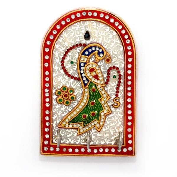 Buy Golden Peacock Meenakari Work Marble Online in Anand  This Key holder demonstrates the artistic skills of craftsmen from Rajasthan. A masterpiece in marble! Buy Little India Golden Peacock white marble key holder with Meenakari Work at the best price. stones used here are ground to a fine dust, and placed and pasted on the backside of an acrylic or glass sheet pinhead point by pinhead point. No machinery is used, the work is done entirely by hand.   Click on the below link to view the product:  http://littleindia.co.in/golden-peacock-meenakari-work-marble-3-key-holder-380/p516