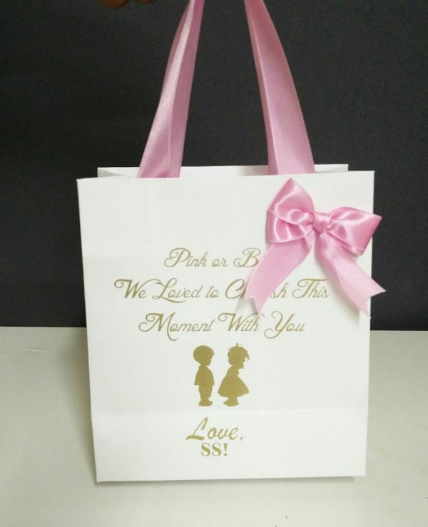 Pink or blue you get the best of best to carry  your return gifts in had made paper bags which are elegantly crafted to compliment your party and gift. This is lamitnated paper bag with matt finishing with matching satin bow and satin ribbon handle.