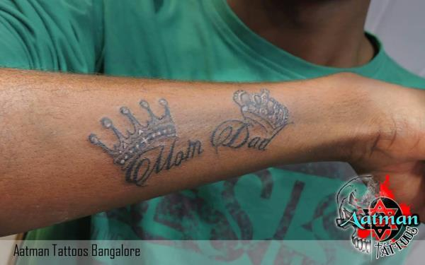 mom dad tattoo in bangalore. this one is a true tribute to your mom and dad. all people who want to dedecate something to their parent they use this type of text tattoo, in the same type you can find dad little girl tattoo,  dad angel tattoo and many more in our tattoo studio in bangalore