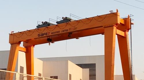 We make electrically overhead traveling industrial cranes that are designed & manufactured in accordance with IS: 3177 and IS :4137.Considering adequate factor of safety with respect to appropriate duty.The structural parts of the cranes are designed in Accordance with IS: 807. Safex also manufactures cranes as per international standards. Safex cranes are manufactured with standard components and controls to ensure reliability.  Standard Features:  1. Safex cranes have high quality structural assembly which ensures  acquiescence with ISO 4301 2. Safex cranes have minimum maintenance and emergency interlude 3. Easily adjustable limit-switches 4. Load tested to 125% and certified by Safex from tests undertaken in our own workshops  Range of Specifications:  1. Safe Working Load: 500 kgs. to 2, 00, 000 kgs. 2. Span: 5 mtrs  to 75 mtrs 3. Height of Lift: As per customer specifications 4. Class of Duty / Standards: Equivalent to M3, M5, M7, M8 as per IS 3177 / IS 807 5. Speeds: Selected depending on client specifications / applications / shed dimensions 6. Crane Control: From floor through Pendant Push Buttons, Optionally through Radio Remote Control / cabin with master control 7. Drive System: Twin Drive through Squirrel Cage Induction Geared Motors with built-in fail safe brakes 8. Motors: Squirrel Cage Induction Hoisting Motors with built-in fail safe brakes for Hoisting, Cross Travel as well as Long Travel. Insulation Class for all motors B/F 9. Brakes: Built-in Brakes for Hoisting, Cross Travel and Long Travel motions 10.Power Supply System: To Hoist and Cross Travel through Trailing Cables / Drag Chain To Crane through Shrouded Bus Bars / Trailing Cable / MS Angle Iron Conductors / Bare Copper Conductors (depending on customer's choice and application)