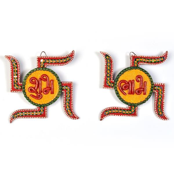 Buy Unique Kundan Swastik Shubh Labh Door Hanging Online in Bareily  This Beautiful handcrafted swastika shaped shubh labh door hanging is made up of wood and decorated with kundan meenakari work. The gift piece has been prepared by the creative artisans of Jaipur. The door hanging is an ideal decorative piece for your home. It is also an ideal gift for your friends and relatives.  Click on the below link to view the product:  http://littleindia.co.in/unique-kundan-swastik-shubh-labh-door-hanging-254/p553