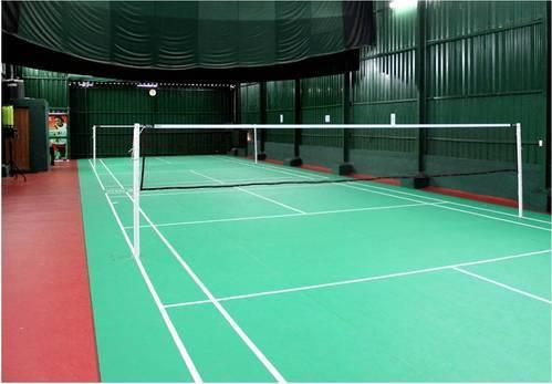 Badminton Court Flooring  We Sundek Sports Systems are manufacturers of Badminton Court Flooring in Mumbai.  As well as in India. Product Details: We Provides	Wooden Flooring, PU / PVC Flooring, Vinyl, Synthetic and Rubber Flooring Provide AMC	No Service Location/City	India Other Available Services	Tennis Court Flooring, Basketball Flooring, Volley Ball Court Flooring, Squash Court Flooring, Gymnasium Flooring  We are offering Official Badminton Court Flooring to our clients. The free floating resilient wooden sports flooring system designed for, Badminton Halls made of Indian and imported timbers. The system ensures that there is no impact on the knees, feet, shins and ankles.  Features: 6.7 to 10 MM product that is internationally approved by BWF and FIBA with thick foam backing and a tough vinyl wear layer of 1.3 MM. Products have a warranty of 10 years. 6.7 MM is in stock  Technical Specifications: Multiple thicknesses available: 10 MM to 4 MM are possible Warranties: 5 to 12 years depending on the product Dense vinyl wear layer with a T class wear layer. European wear layers are substantially denser than those coming from the Far East High-quality PUR coating which comes with high micron density so as to protect the floor underneath Glass fiber layer which ensures dimensional stability Dense foam: High-quality foam which does not compress and is chemically bonded to top layers to avoid delamination over time Passes all EN norms for sports flooring under EN 14904  Advantages / Benefits: Outstanding Shock Absorption Efficient Joint and Cartilage Protection. Due to excellent shock absorption, they provide a long-term protection of athletes' joints and cartilages during regular sporting sessions.  Optimal Traction Coefficient: A Perfectly Balanced Grip and Slip The unique surface design ensures a balanced level of friction that facilitates quick direction change and reduces the risk of slips and trips.  Optimal Vertical Deformation: Advanced Comfort Special foam backing provides optimal vertical deformation, increasing the comfort and reducing the risk of physical injuries.  Consistent Ball Bounce: Excellent Athletic Performance These floorings are ideal for team ball sports, as they do not affect the play and deliver consistent rebound and spin characteristics.  The intelligent surface which provides excellent abrasion resistance and easy cleanability: The durable and easily cleanable surface which has optimal grip and slip character. High energy absorption due to the lower foam layer – comfort and protection. Optimized deformation shape through the upper foam layer – easy direction change and reduced risk of injury. Our vinyl floor coverings are 100% recyclable. Almost 100% of our manufacturing waste is recycled. We make efforts to improve the recycled content in our products. Our products do not require any periodical surface treatment, which results in low maintenance costs. Cross-linked surface which increases the wear resistance and prevents dirt adhesion. A special bacteriostatic composition of the surface layer reduces the risk of infection in case of an injury.