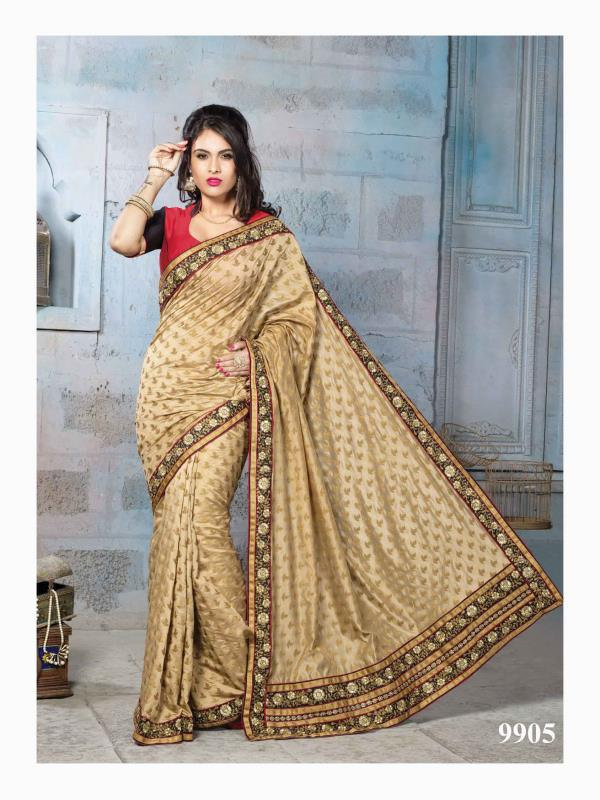 Make an elegant move with this beige art silk jacquard saree detailed with zari and patch border.   http://www.silk-india.com/en/designer-sarees/819-beige-poly-saree-with-traditional-heavy-zari-cod-dori-embroidery-blouse-.html