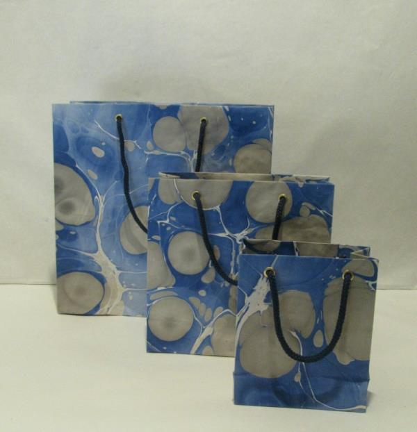 Designer Bags are made with the Marble Handmade paper sheets on which artistic  Handmade prints are done with the trained people. These bags are so unique & attractive which can be used for gifting, boutiques & events. Sizes can be customized according to client requirements.