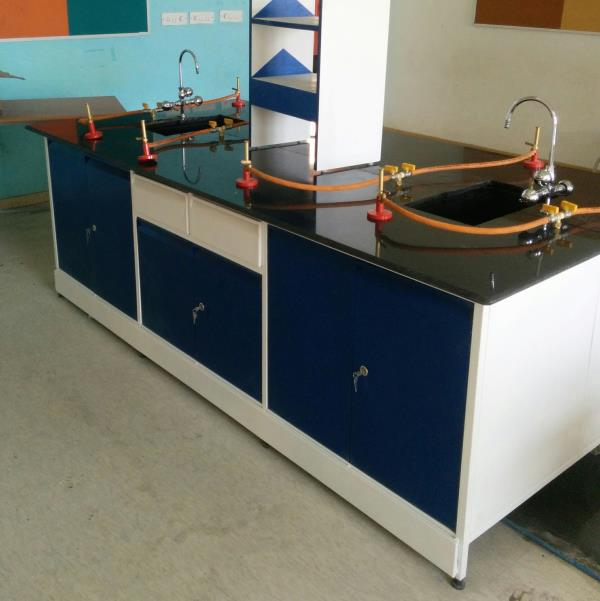 Laboratory table for schools  This Lab table is a fast moving lab furniture accessory.  It is equipped with  Granite Top Storage facility below Regent rack for storing chemicals 2 PP sinks 2 lab water taps 2 gas taps gas connection 4 bunsen burner Plumbing connections Drain connections