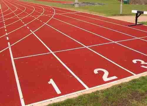 Pre-Fabricated Athletic Track  We Sundek Sports Systems are manufacturers of Pre-Fabricated Athletic Track in Mumbai.  As well as in India. Product Details: LengthCustomized Width Customized Color Green Thickness 25mm The Pre-Fabricated Athletic Track surfaces are globally recognized. The pre-fabricated mat is IAAF (International Association of Athletics federations) approved and is totally environmentally friendly. The pre-fabricated rubber athletic tracks are a new technology and are replacing the old PU track. It is embossed one-time and workmanship gives the productvery good quality and at the same time strong resistance to water, shock-absorbent, excellent elasticity, anti-slippery, anti-aging and long lasting durability. And further, the biggest advantage of the pre-fabricated mat is that the rubber granules do not break off from the surface. Other Details: The pre-fabricated rubber mat is stuck to the asphalt base with the (PU/E) supreme adhesive which is a mixture of PU and Epoxy. It is specially used to lay the Pre Fabricated Rubber Mat for athletic track. The two components adhesive solidifies quickly with stable chemical and weathering properties. It is ideal for sticking the rubber surface onto the asphalt base and approved to be environmentally friendly.