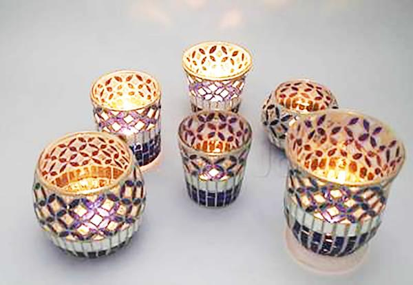 Mosaic Candle Holders   Candle holders available in various sizes, shapes and heights.They make an elegant Ambience as dinner party center pieces. light up any and every occassions with the perfect candle holder.