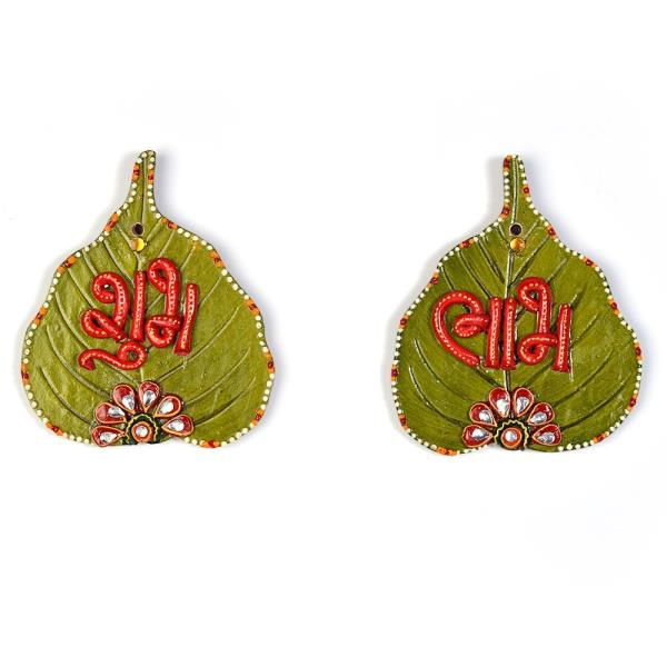 Buy Designer Paan Shape Shubh Labh Door Hanging Online.   This Beautiful handcrafted paan shaped green shubh labh door hanging is made up of wood and decorated with kundan meenakari work. The gift piece has been prepared by the creative artisans of Jaipur. The door hanging is an ideal decorative piece for your home. It is also an ideal gift for your friends and relatives.  Click on the below link to view the product:   http://littleindia.co.in/designer-paan-shape-shubh-labh-door-hanging-253/p552