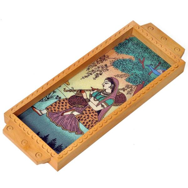 Buy Jaipuri Meera Gemstone Painted Wooden Serving Tray Online.   This Handcrafted serving Tray is made of wood and adorned with traditional Gemstone Meera Painting. The painting is hand made with finely crushed real gemstones on a glass base. The gift piece has been prepared by the creative artisans of Jaipur.  It is an ideal utility item to serve your guests or for your day to day use. It is also an ideal gift for your friends and relatives.  Click on the below link to view the product:   http://littleindia.co.in/jaipuri-meera-gemstone-painted-wooden-serving-tray-441/p462