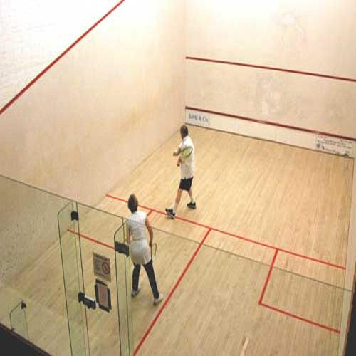 Indoor Squash Court  We Sundek Sports Systems are manufacturers of Indoor Squash Court in Mumbai.  As well as in India. Product Details: Dimensions9.75m in length, 6.4m in width and 5.64m in height We provide Squash Court that is highly appreciated by schools, offices, clubs, sport organizations, and so forth. Technically advanced design and sound layout system make the Squash Court highly efficient. Our Squash Court is made in accordance with the standards of WSF (World Squash Federation). It comprises kiln seasoned/dried imported American hard maple or European sycamore wood surface board that offers it durability. The below frame is fabricated from fir/spruce/pine wood runners which is imported from New Zealand/Australia or Germany. Our Squash Court meet all the safety requirements and building codes owing to which it can easily withstand the breakage.  Specifications: Court size : 975 cm (32 feet) length and 640 cm (21 feet) wide Front Wall Line : 457 cm (15 feet) above the floor that is connected by a raking