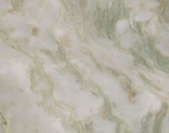 ONYX GREEN MARBLE  Onyx Green or as it is popularly called as Lady Onyx Green Marble is white base Indian Marble with swirls of Green and pink colors. Both Onyx Green and Pink are obtained from the same quarry however the selection is made out of prominence of Green or Pink color in the blocks. The marble blocks showing prominence of Green are classified as Lady Onyx Green Marble. The predominant color in the Onyx Green Marble is Green with shades of cream and green woven in the tapestry. Onyx Green Marble tiles are particularly hard wearing and suitable for use in bathrooms, kitchens etc. Marble is the result of extreme heat and pressure applied to Limestone. Rich and warm it can be highly polished creating a lustrous illusion of depth or antiqued for a more rustic or traditional look. Onyx Green Marble is a beautiful marble stone having a grainy look. The stone enhances the beauty of your home/office décor in a manifold way.