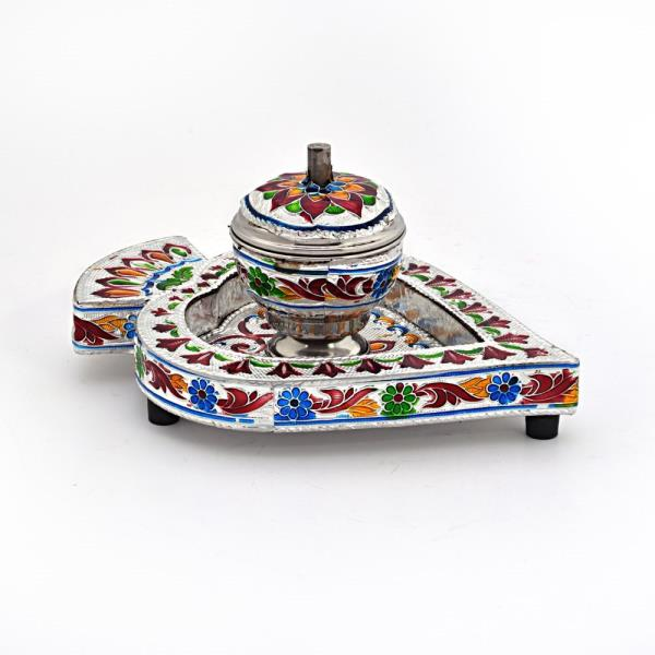 Buy Meenakari Sindoor Box n Tray in White Metal Online.   This handcrafted Silver polished Sindoor container with leaf shaped tray is made of pure white metal. There is a lid to keep it closed after use. The whole piece is decorated with precious meenakari work. The gift piece has been prepared by the master artisans of Jaipur.   Click on the below link to view the product:   http://littleindia.co.in/meenakari-sindoor-box-n-tray-in-white-metal-328/p610