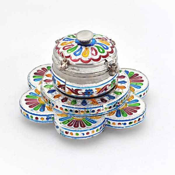 Buy Minakari Work Floral Pan Box With Serving Tray Online.   This handcrafted Silver polished Paan Box with flower shaped tray is made of pure white metal. It is decorated with precious meenakari work all over. There is a lid to keep it closed after use. The gift piece has been prepared by the master artisans of Jaipur.   Click on the below link to view the product:   http://littleindia.co.in/minakari-work-floral-pan-box-with-serving-tray-329/p611