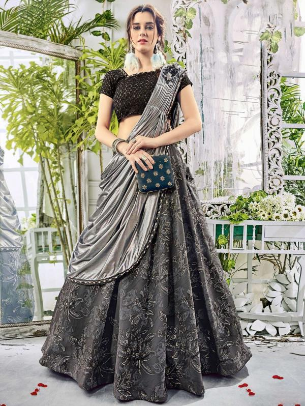 An outstanding play of black with shades of grey, this jacquard lehenga is indeed a smart pick for a grand evening celebration! Subtle floral patterns render elegance to the outfit while a grey lycra and shimmer dupatta gives a perfect style edge to the ensemble. Adding a pair of statement earrings and black or silver clutch will complete your look with a touch of glamour. Detail your look with smokey eyes and soft curls!