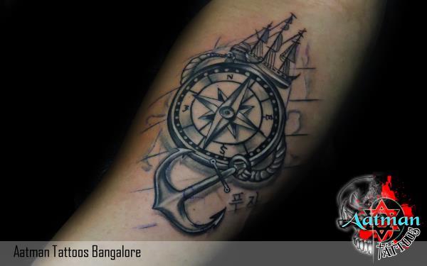 compass tattoo with trishul tattoo and anchor tattoo at tattoo ...