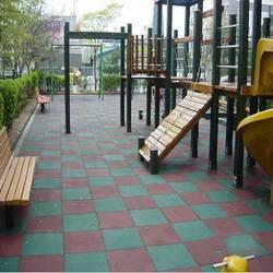 Children Play Area Rubber Flooring  We Sundek Sports Systems are manufacturers of Children Play Area Rubber Flooring in Mumbai.  As well as in India. Product Details: Brand Sundek Children Play Area Rubber Floorings at most reasonable prices. Assuring durability and high skid resistance, these floorings are ideal for children play areas and parks. Clients can lay down these rubber floorings on different kinds of surfaces, including sand, soil, wood and tarmac. To meet the variegated requirements of the clients, we offer these floorings in various colors, patterns and designs. Our range is widely appreciated for the following features: Minimal maintenance cost Easy to assemble Durability