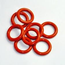 An O-ring, also known as a packing, or a toric joint, is a mechanical gasket in the shape of a torus; it is a loop of elastomer with a round cross-section, designed to be seated in a groove and compressed during assembly between two or more parts, creating a seal at the interface. The O-ring may be used in static applications or in dynamic applications where there is relative motion between the parts and the O-ring. Dynamic examples include rotating pump shafts and hydraulic cylinder pistons.