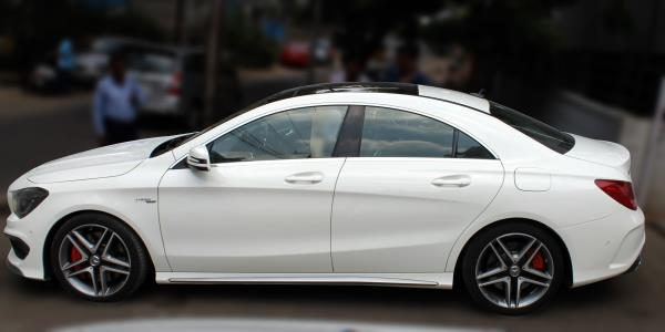 MERCEDES BENZ CLA 45 AMG (WHITE COLOR, PETROL), 2014 model done only 4, 000km in absolute mint condition. For further info call 7569696666
