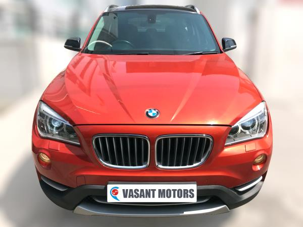 BMW X1 SDRIVE 20D ( VALENCIA ORANGE METALLIC COLOR, DIESEL), 2014 model done only 75, 000km in absolute mint condition. For further info call 7569696666