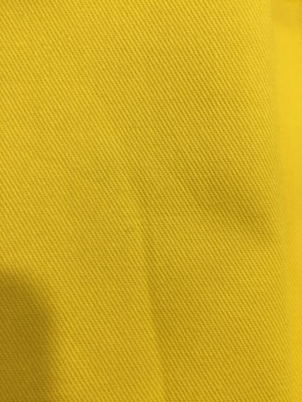 We are manufacturers of  100% Cotton Twill for WorkWear. It is available in 190 gsm , 240 gsm & 270 gsm in Royal Blue , Orange , Yellow , Navy Blue etc.  The fabric meets all Fastness.