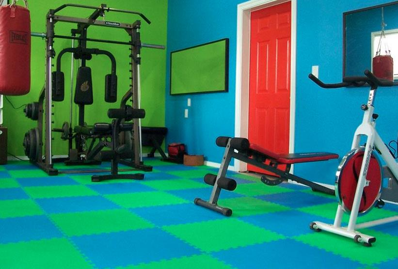 Gym Tiles The rubber gym tiles can be used not only for gymnasiums but also for yoga rooms, kids play rooms and the likes.  Gym tiles are available in a thickness of 12mm. The extra 2 mm provides additional cushioning. 3 colour options of red, black and green are available to give it an aesthetic appeal.  They look extremely appealing and safe on the joints. Helps in ensuring minimum injury.