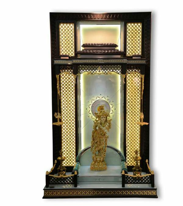 Huge pooja ghar for special pooja room as per client requirement sizes also customize as per client space this mandir is of teakwood plywood 24 CRT Gold leafing  mandir design it is easy maintain No effect of oil  haldi kumkum water on glass top . Light effect as per meditation.