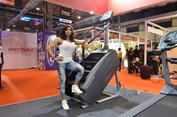 Yashmeen chauhan brand ambassador of nortus fitness india at body power expo mumbai on stairfit machine by nortus fitness.