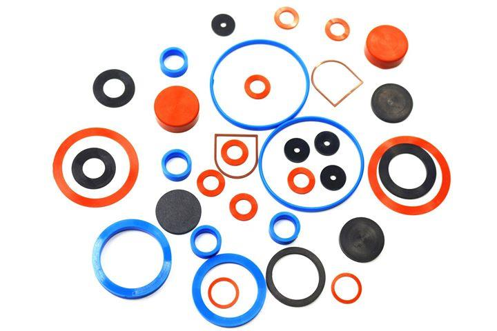Silicone Rubber Gaskets Polysiloxane (VMQ)  Himsan Polymer is a recognized leading manufacturer of high quality silicone rubber gaskets, seals, and custom silicone products. Our company's reputation for excellence has been built on our ability to provide our valued customers with the most effective designing, engineering and manufacturing solutions to meet their most demanding applications. Our main objective is to continuously exceed our customer's expectations by providing them with high performance gaskets and sealing products, competitive pricing, on-time delivery and exceptional customer service. Himsan Polymer maintains a modern manufacturing facility along with knowledgeable, technically-oriented professionals enabling us to consistently meet all of your blueprint specifications and tolerance requirements.  Silicone rubber is a high-performance elastomer with exceptional resistance to temperature extremes. Silicone molded and die cut gaskets remain functional within a temperature range of -67°F to +400°F, intermittent to +450°F. The low temperature flexibility of silicone is unmatched by any other elastomer. Silicone gaskets are often chosen due to their excellent resistance to chemicals, water, fire, fungal growth, ozone, heat and aging. Silicone has outstanding tensile strength, elongation, tear strength, and compression set. The versatility and long service life of silicone make it ideal for a wide variety of applications.  Molded Silicone Gaskets  Himsan Polymer specializes in the manufacturing of molded silicone gaskets and seals. We commonly mold products using silicone, fluorosilicone, and FDA (food grade) silicone compounds which are available in color options red/orange, black, gray, blue, white, and translucent with custom color compounding available upon request. Silicone rubber molding compounds durometer (hardness) typically ranges from 25 to 80 durometer, Shore A. Silicone rubber molding tolerances are compliant with rubber molding industry stan